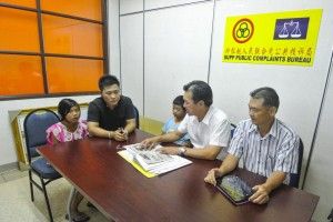 The father of two listening to SUPP PCB Bureau Chief Wilfred Yap. To his right is PCB Committee member, Cr. Yeo Eng Kwang